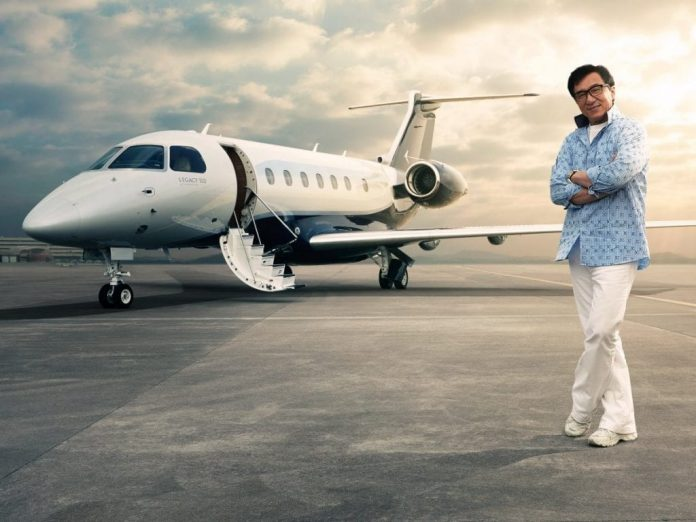 WEALTHY CHINESE TRAVELLERS READY TO BOARD THEIR PRIVATE JET